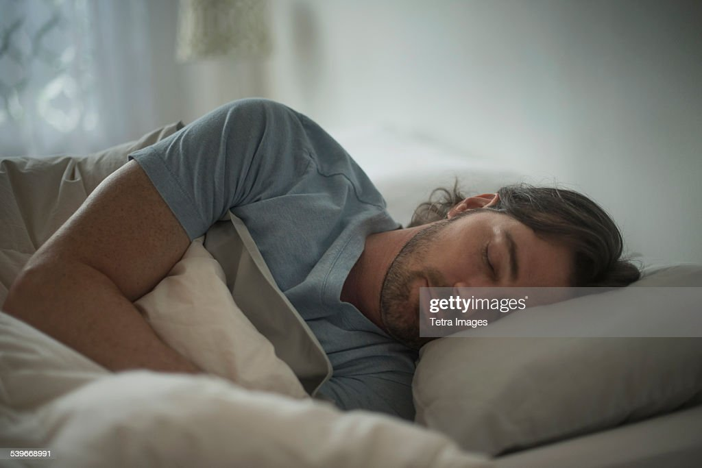 USA, New Jersey, Man sleeping in bed : Stock Photo