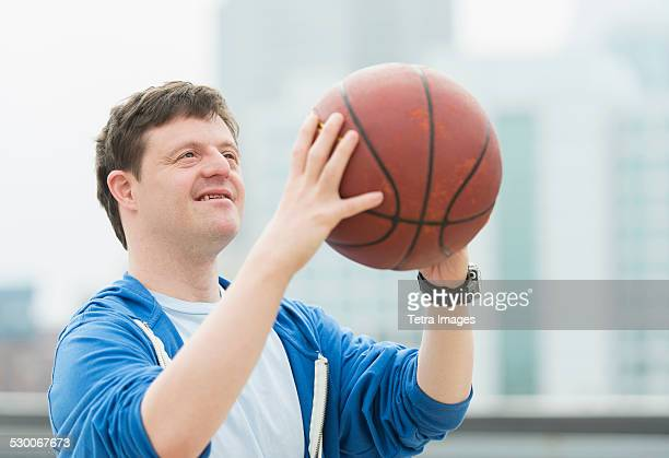 USA, New Jersey, Man with down syndrome playing basketball