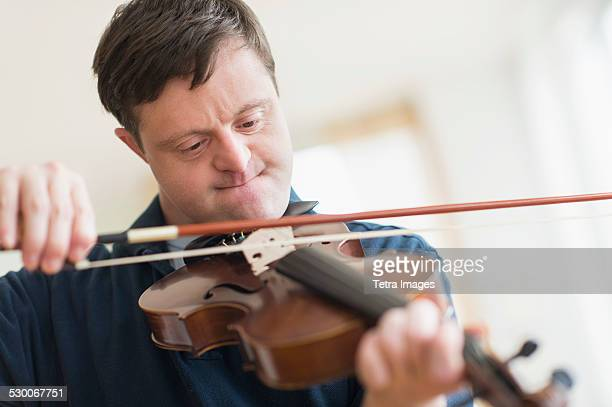 USA, New Jersey, Man with down syndrome playing violin