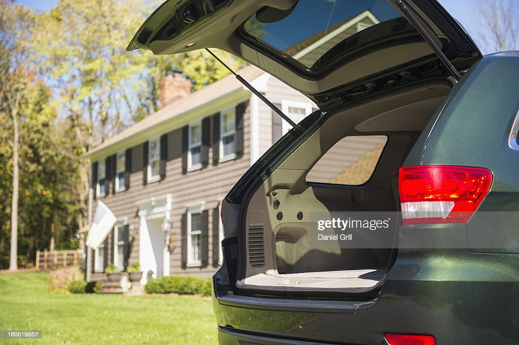 USA, New Jersey, Mendham, Open car trunk in front of house : Stock Photo
