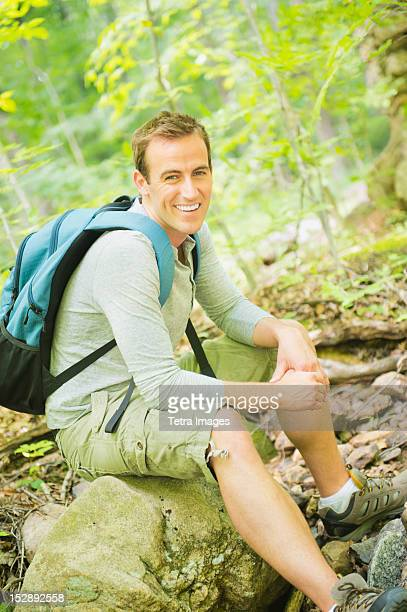 USA, New Jersey, Mendham, Portrait of man resting in forest