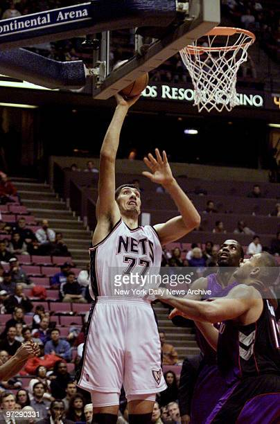 New Jersey Nets' #77 Gheorghe Muresan shoots during game against the Toronto Raptors at Continental Air Arena
