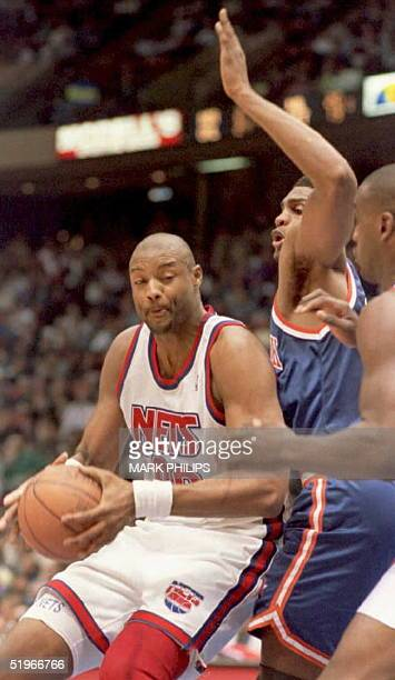 New Jersey Nets Benoit Benjamin is surrounded by New York Knicks Charles Smith and Anthony Mason as he tries to go to the basket in the first half of...