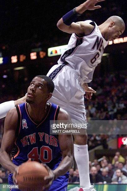 New Jersey Nets forward Kenyon Martin sails past New York Knicks center Kurt Thomas after Thomas pump faked to the basket in the first quarter 22...