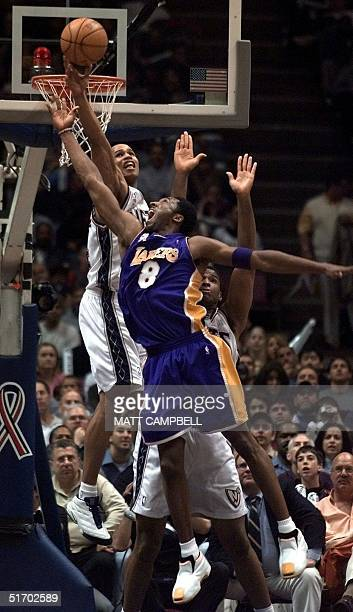 New Jersey Nets forward Richard Jefferson blocks a shot by Los Angeles Lakers guard Kobe Bryant in the fourth quarter 03 April 2002 at Continental...