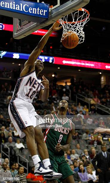 New Jersey Nets guard Ben Uzoh in front of Milwaukee Bucks power forward Larry Sanders at the Prudential Center in January 8 2011 in Newark NJ