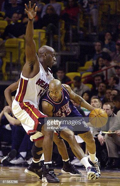 New Jersey Nets' guard Stephon Marbury tries to drive the ball past Miami Heat forward Anthony Mason during 1st period action of their game 04...