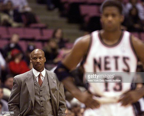 New Jersey Nets' head coach Byron Scott watches as a foul shot is taken as his team faces off against the Cleveland Caveliers at Continental Airlines...