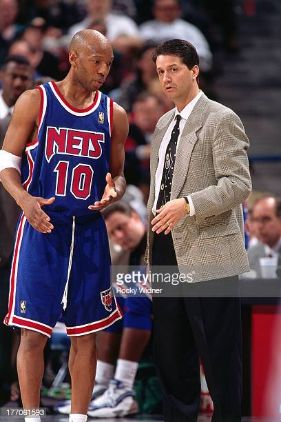 New Jersey Nets head coach John Calipari talks with Sam Cassell against the Sacramento Kings on March 3 1997 at Arco Arena in Sacramento California...