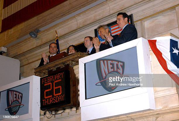 New Jersey Nets Head Coach Lawrence Frank center rings the opening bell at the NYSE February 26 2004