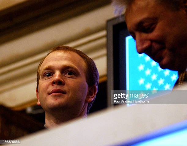 New Jersey Nets Head Coach Lawrence Frank left rings the opening bell at the NYSE February 26 2004
