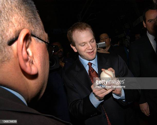 New Jersey Nets Head Coach Lawrence Frank signs a baseball from an autograph seeker on the floor of the NYSE prior to ringing the opening bell...