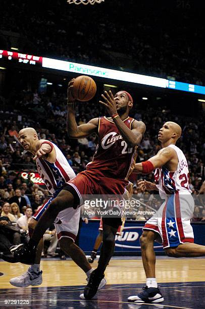 New Jersey Nets' Jason Kidd and Richard Jefferson defend against the Cleveland Cavaliers' LeBron James during the fourth quarter of game at...