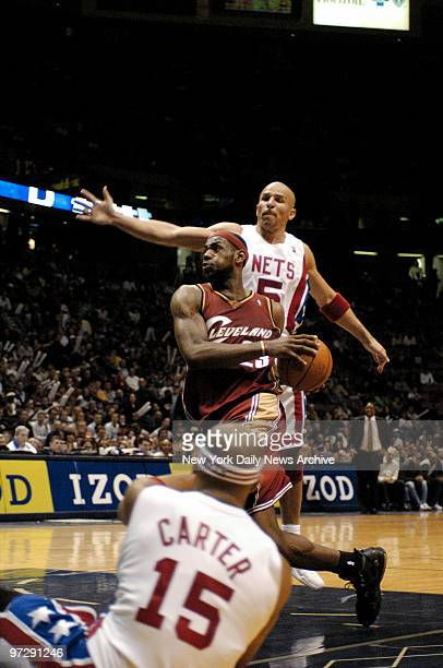 New Jersey Nets' Jason Kidd and Vince Carter defend against the Cleveland Cavaliers' LeBron James during the fourth quarter of game at Continental...