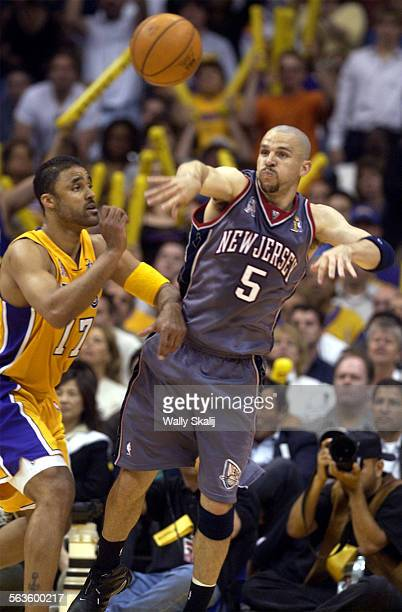 d2d6adc3e9e New Jersey Nets Jason Kidd passes the ball off over the Los Angeles Lakers Rick  Fox