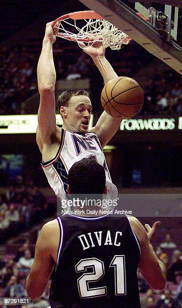 New Jersey Nets' Keith Van Horn slam dunks the ball over Sacramento Kings' Vlade Divac during game at Continental Airlines Arena.