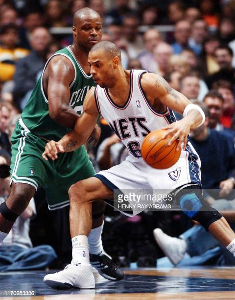 New Jersey Nets' Kenyon Martin drives on the Boston Celtics' Antoine Walker in the second quarter at Continental Airlines Arena in East Rutherford...