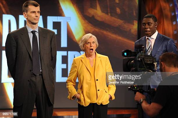 New Jersey Nets owner Mikhail Prokhorov Irene Pollin owner of the Washington Wizards and Jrue Holiday of the Philadelphia 76ers reacts during the...