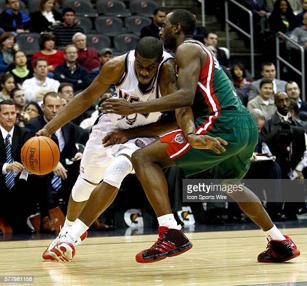 New Jersey Nets power forward Derrick Favors drives around Milwaukee Bucks small forward Luc Richard Mbah a Moute at the Prudential Center in January...