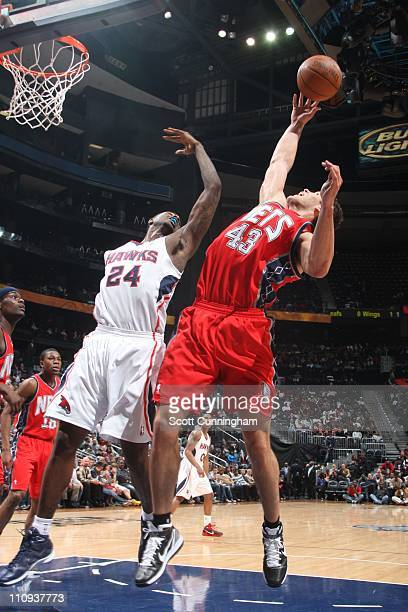 New Jersey Nets power forward Kris Humphries protects the ball from Atlanta Hawks small forward Marvin Williams during the game against the Atlanta...