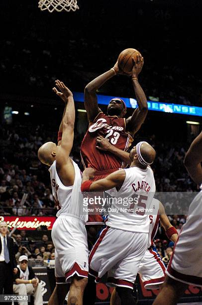 New Jersey Nets' Richard Jefferson and Vince Carter defend against the Cleveland Cavaliers' LeBron James during the fourth quarter of game at...