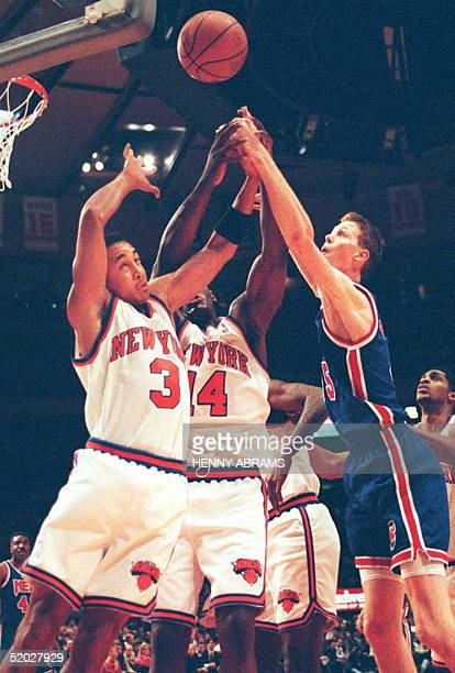 New Jersey Nets' Shawn Bradley battles the New York Knicks' John Starks and Anthony Mason for a rebound in the first quarter at Madison Square Garden...