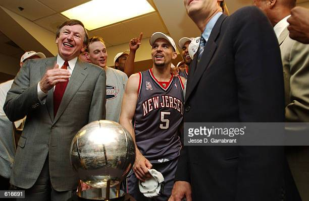 New Jersey Nets Team President Rod Thorn along with Jason Kidd celebrate receiving the Eastern Conference Championship Trophy after beating the...