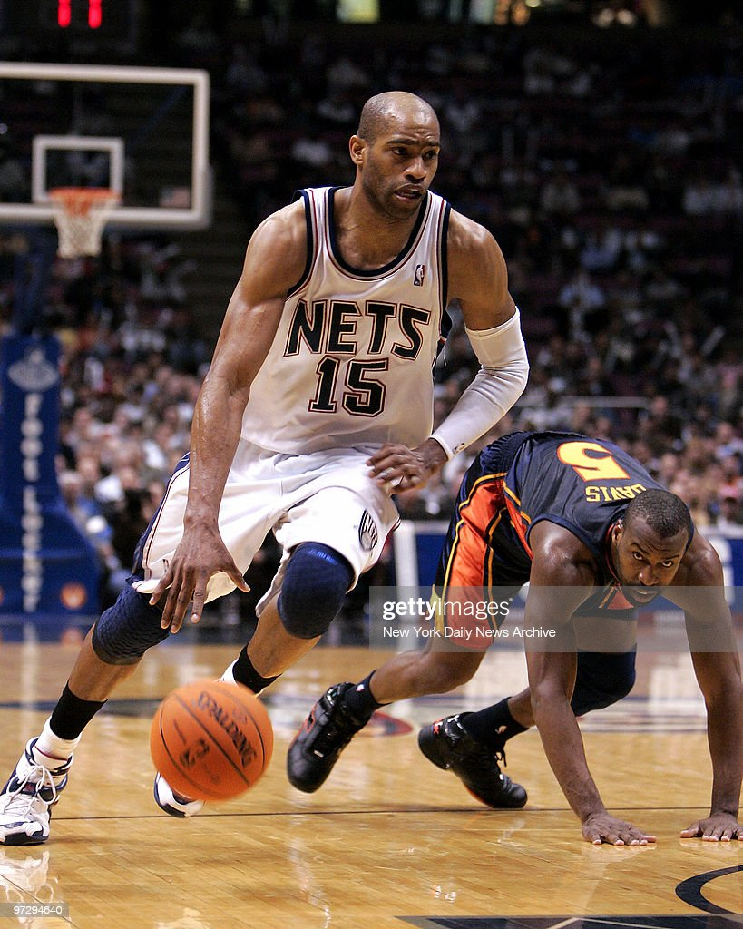 72f401c7f5a New Jersey Nets' Vince Carter gets the ball around Golden St : News Photo