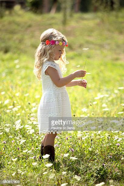 USA, New Jersey, Oldwick, Cute girl (4-5) in white dress standing in meadow