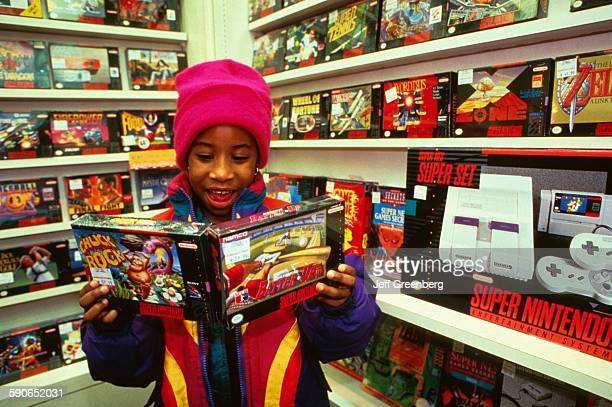 New Jersey, Paramus, Child Looking At Nintendo Packaging, Computer Software, Retail.