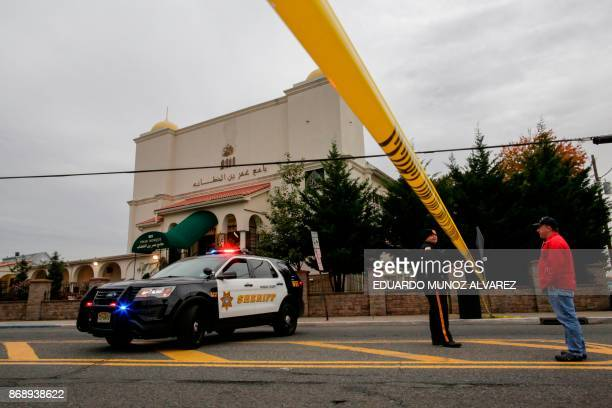 New Jersey police officer stands guard in front of the Omar Mosque on November 1 in Paterson New Jersey A pickup driver killed eight people in New...