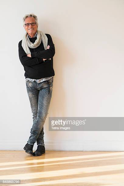 usa, new jersey, portrait of fashionable senior man - leaning stock pictures, royalty-free photos & images