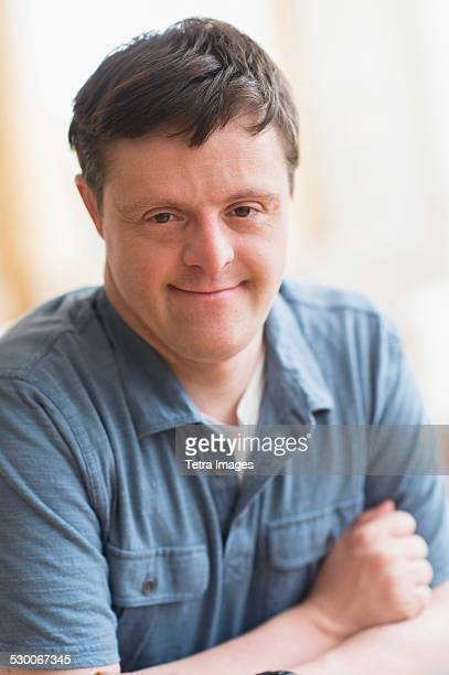 usa, new jersey, portrait of man with down syndrome - leaning disability stock pictures, royalty-free photos & images