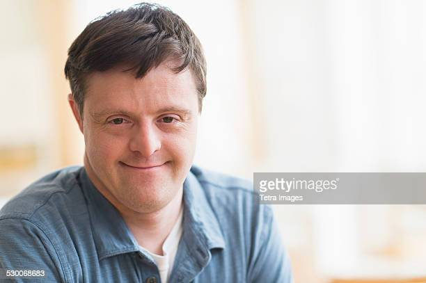 usa, new jersey, portrait of man with down syndrome - down syndrome stock pictures, royalty-free photos & images