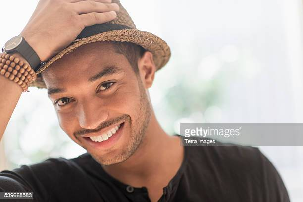 USA, New Jersey, Portrait of smiling man in straw hat
