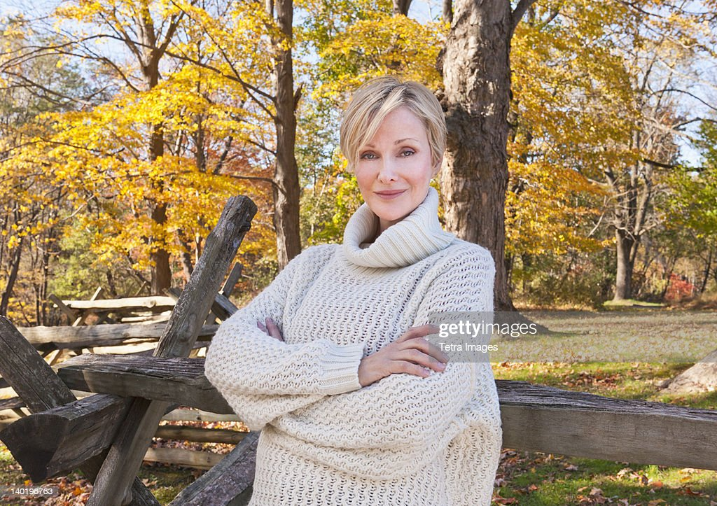 USA, New Jersey, Portrait of smiling woman in Autumn forest : Stock Photo