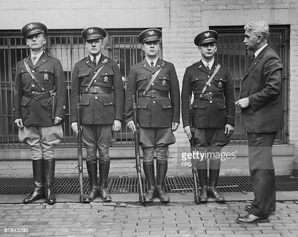 New Jersey prohibition director Colonel Ira Reeves inspects a group of dry agents in their new uniforms circa 1927 The men Earl McManys Harry L...