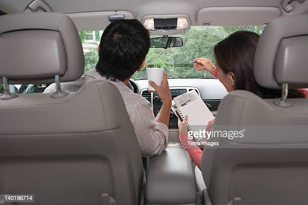 USA, New Jersey, Rear view of couple in car