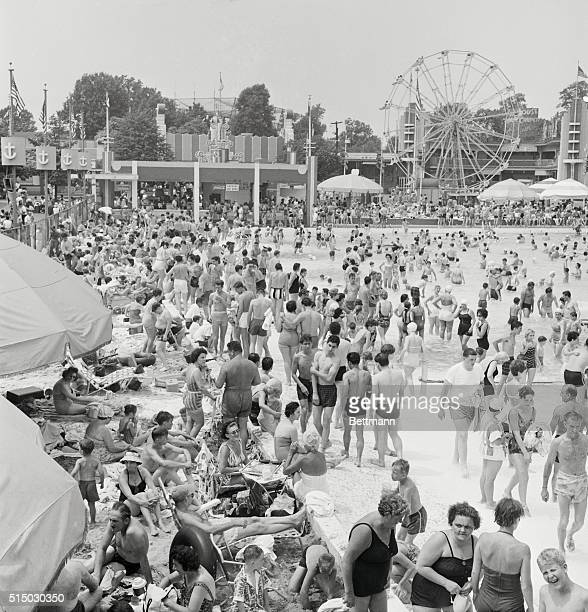Record crowds gather at the Palisades Amusement Park New Jersey to beat the heat as the mercury soars Thousands of people flocked to the world's...