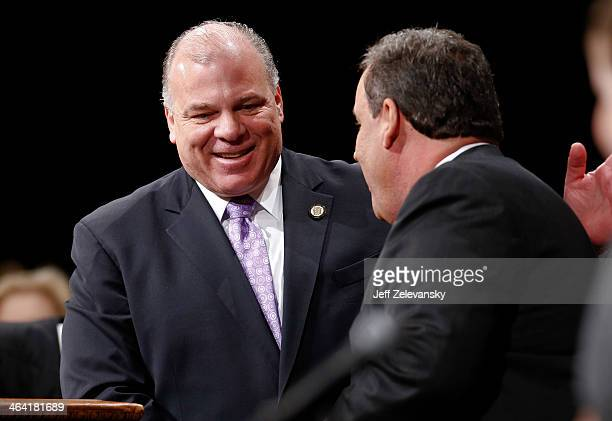 New Jersey Senate President Steve Sweeney greets New Jersey Gov Chris Christie prior to being sworn in for his second term on January 21 2014 at the...