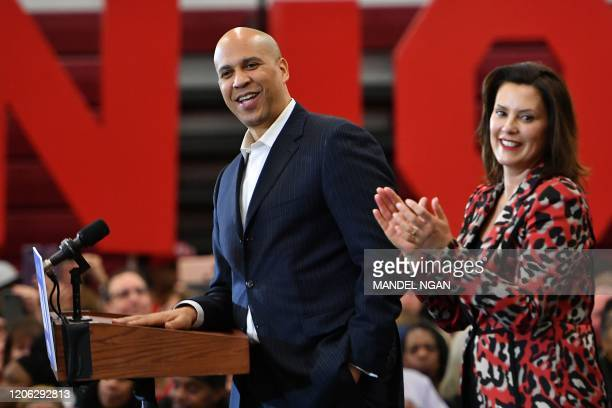 New Jersey Senator Cory Booker speaks onstage alongside Michigan Governor Gretchen Whitmer during a Democratic presidential candidate Joe Biden's...