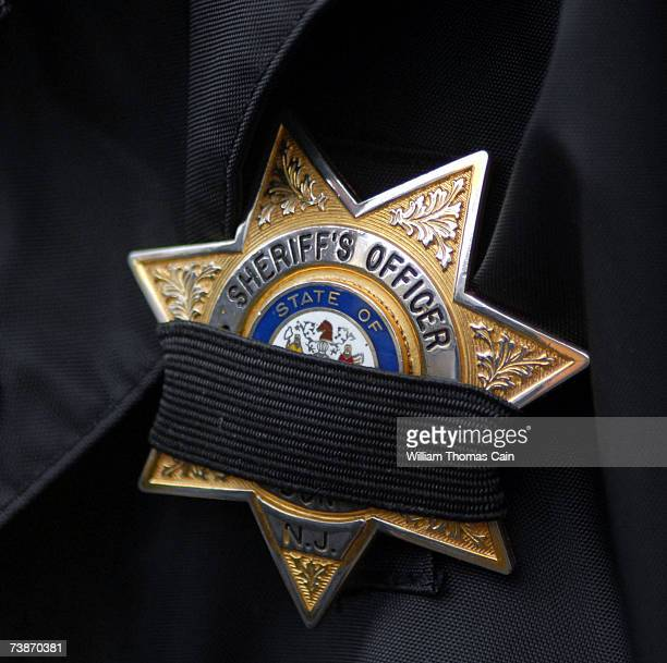 New Jersey Sheriff's badge is draped with a black band at the funeral for slain FBI agent Barry Lee Bush at the Hill School Center for the Arts April...