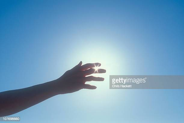USA, New Jersey, Silhouette of woman's hand against sky