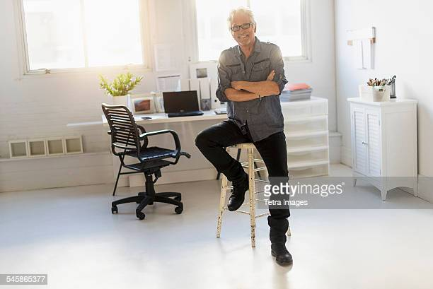 USA, New Jersey, Small business owner in his office