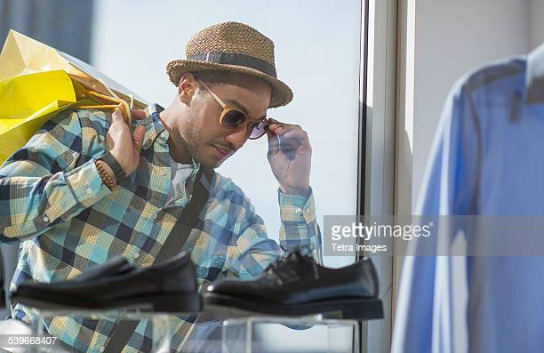 USA, New Jersey, Stylish man window shopping