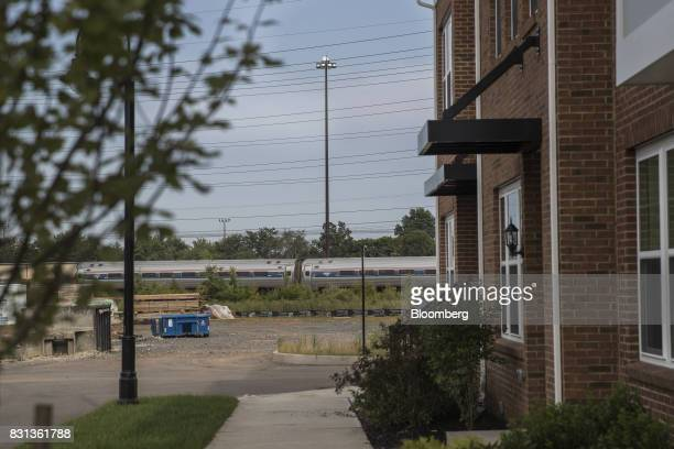 A New Jersey Transit train passes in front of construction material at a site in North Brunswick New Jersey US on Thursday Aug 10 2017 Between US...