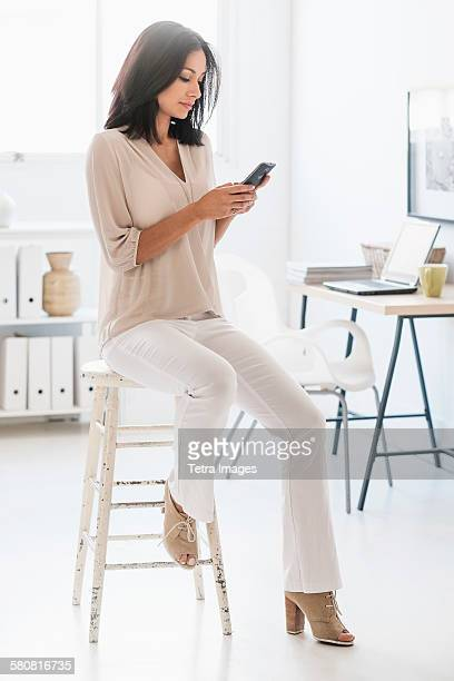 USA, New Jersey, Woman using smart phone