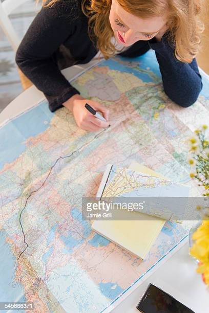 USA, New Jersey, Young woman planning road trip