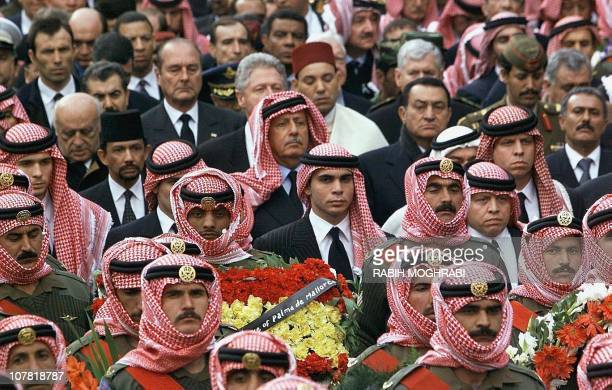 New Jordanian King Abdallah and his brother Ali accompany King Hussein's coffin as well as Turkish President Suleyman Demirel French President...