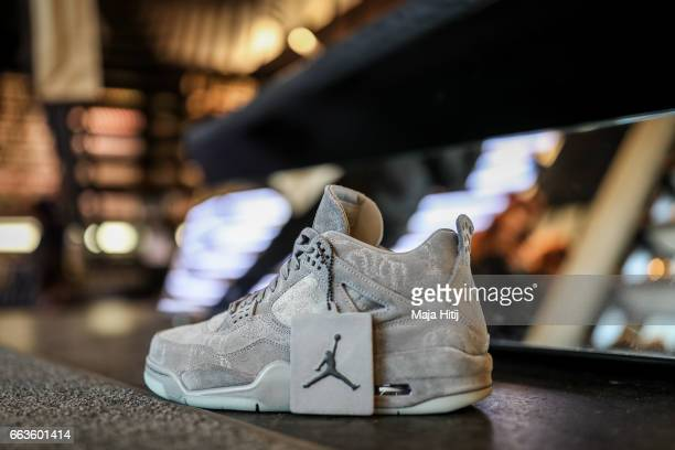 New KAWS x Air Jordan IV sneaker during the sale at Overkill sneakers store on March 31 2017 in Berlin Germany Several dozen diehard sneakers fans...
